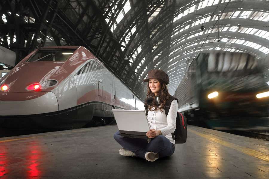 Girl-with-Laptop-Train-Platform