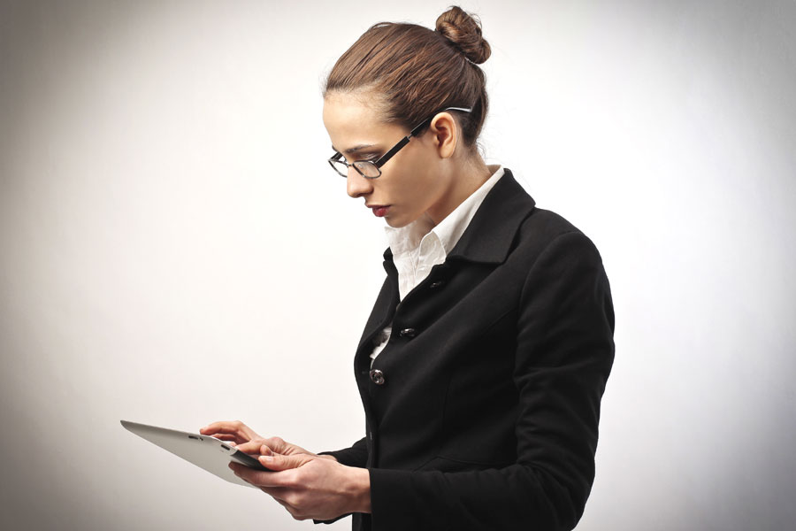 Woman-using-tablet-device