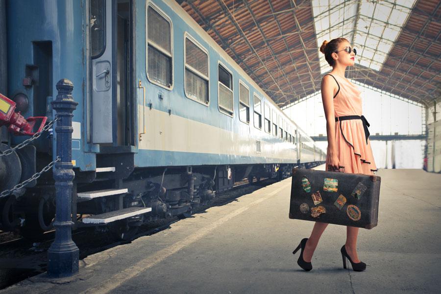Woman-with-Suitcase-Train-Platform